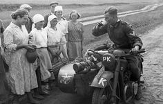 1941 German soldier on motorcycle being welcomed by Russian women