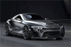 Aspid GT-21 Invictus: Surprisingly, this is not the new Batmobile. It's the first production model from Spain's supercar company Aspid. With a spaceframe chassis and composite body panels, the GT-21's BMW V8 will rip 0-60 sub three and boasts a top speed near 200MPH. It's due out in 2014 with no word on the pricetag yet.