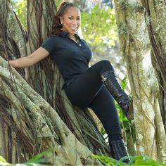 Marjorie Harvey posing in a tree.