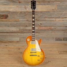 Designed not by Les Paul but by past Gibson president Ted McCarty and factory manager John Huis, the Gibson Les Paul Standard has become arguably one of the Guitar Logo, Prs Guitar, Acoustic Guitars, Guitar Tattoo, Gibson Les Paul, Gibson Gold Top, Gibson Custom Shop, Les Paul Guitars, Cool Electric Guitars