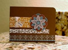 I love this paper from Stampin' Up - Spice Cake! I did my whole craft room in this paper!