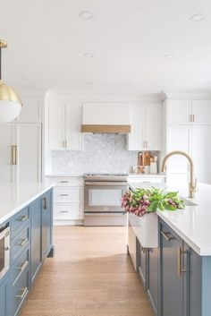 Beautiful blue and white kitchen with gold accents