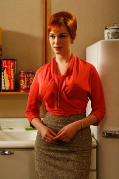 Christina Hendricks as Joan in a fashionable Orange blouse from season 1  Mad Men's Best Fashion - Fashion From Mad Men