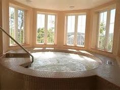 Here\'s an octagon shaped indoor hot tub sunken into a wooden deck ...