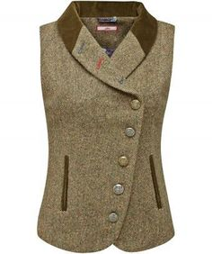"Bring a touch of the English countryside to your look with this tweed waistcoat. Assorted buttons and contrast buttonholes add a twist to the traditional feel. Layer it over a casual blouse to add heritage style to your outfit. Approx Length: 61cm Our model is: 5'7"" Shirt sold separately"