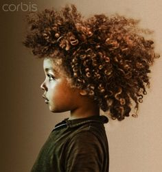 beautiful mixed race boy with curly hair
