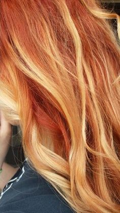 Red hair with blonde highlights.