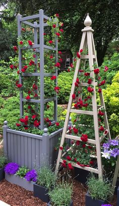 Tower obelisk with planter painted Deep Lead with red roses at RHS Chelsea Flower Show 2017
