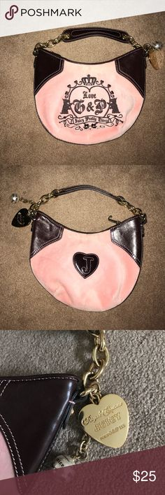 Authentic Juicy Couture shoulder bag Excellent condition (besides one small stain as shown in picture) mini Juicy Couture over the shoulder lag. Light pink and dark brown with gold hardware. Perfect for a little girl :) Juicy Couture Accessories Bags