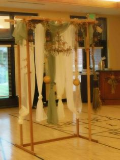 Gypsy/Pagan wedding style trellis we made. notice the broom on the right side. They jumped the broom and the lanterns were what the bridesmaids carried during the procession then put them back on the trellis..also the chandelier is an antique complete with crystals.