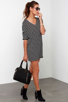 Lulus Exclusive! For a casual cute dress you can wear over and over (and over and over!), get the Repeat After Me Black Striped Dress! This stretch knit dress has a relaxing shift shape, topped with a V neckline and short sleeves. Thin white lines bring extra style to keep it repeat worthy. Unlined. 96% Rayon, 4% Spandex. Dry Clean Only.