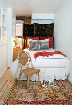 small guest room, screen as headboard, oriental rug