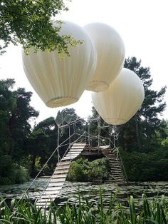What you see here is a suspended bridge tatton's japanese garden by artist Oliveier Grossetête. it is literally a wooden bridge floating under helium filled balloons.