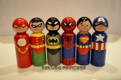 Superhero peg dolls..neat! My only question is, where are Batman's ears?!
