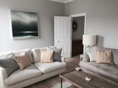 Sitting Room. Farrow and Ball Cornforth White Walls. Jonesy Sofa Loaf. Mark Poprawski Painting 'One too many mornings'