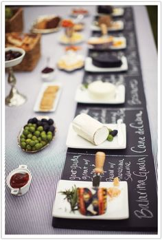 Wine and cheese buffet. We had a buffet as well but had it separate from the wine and cheese pairings. Fabulous idea to have the chalkboard under each for a description. Instead of the chalkboard and chalk, however (we were afraid to mix chalk and food) we used a big sheet of white paper and a black crayon for people to write their cheese and wine pairing.