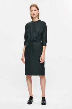 Designed with a drawstring waist, this shirt dress is made from a lightweight wool with a slight stretch. Cut to be loosely fitted in the body and with a close skirt, it has a neat grandad collar, subtle in-seam pockets and hidden front buttons.
