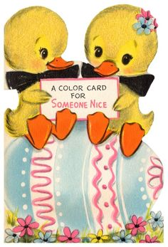 vintage easter card - two adorable ducks sitting on an easter egg