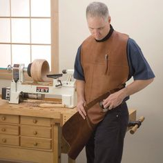 Protect yourself from dust, flying chips and shaving while turning with this woodturner's leather apron.