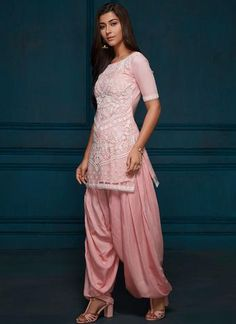 Pink and White Thread Embroidered Punjabi Suit features a georgette kameez with santoon inner, santoon salwar bottom and white net dupatta. Embroidery work is completed with thread embellishments on this style. Indian Fashion Dresses, Dress Indian Style, Indian Outfits, Western Outfits, Indian Wear, Fashion Outfits, Simple Indian Suits, Ladies Suits Indian, Punjabi Suit Neck Designs