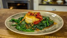 Skrei cod a La Llauna, spinach and piquillo peppers
