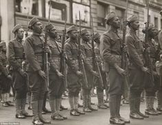 "In 1920 Chicago: Black-American Soldiers After World War I: Regiment Infantry, The ""Buffaloes"", presented with colors. The ""Buffaloes"" singing the National Anthem in front of the Union League Club, New York City. Black History Facts, Us History, World War One, First World, Puerto Rico, War Image, American Soldiers, African American History, Military History"