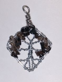 """Tree of Life Pendant    Smoky Quartz Beads    2"""" in Length    1-1/4"""" in Width   Shop this product here: http://spreesy.com/classygalcreations/138   Shop all of our products at http://spreesy.com/classygalcreations      Pinterest selling powered by Spreesy.com"""