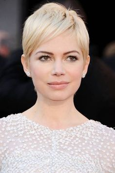 """ROUND FACE:  angular short cuts are best for a round face (think an asymmetrical bob or a pixie with side-swept bangs). """"A rounder face tends to have less shape to it—while straight hair will lengthen, angles in the haircut will add shape and symmetry,"""