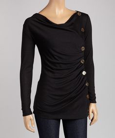"""Easy, breezy and effortlessly on-trend, this tantalizing top radiates casual allure. With its delicately draped front and eye-catching button embellishments, it's loaded with stylish appeal.Measurements (size S): 30"""" long from high point of shoulder to hem65% polyester / 30% rayon / 5% spandexHand wash; hang dryMade in the USA"""