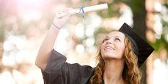 girl holding her diploma at graduation
