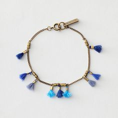 WHO AGAIN MULTI THREAD TASSLE BRACELET. by Bijoux Isabel Marant.