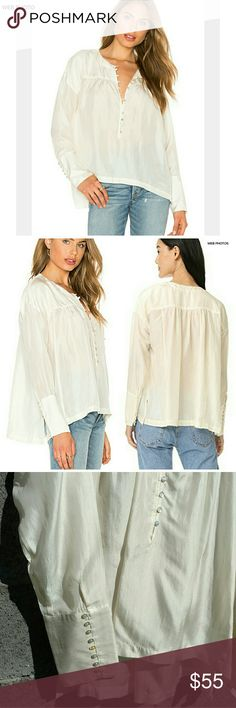 """FREE PEOPLE Live to Tell 100% Silk Blouse Replete with romantic details, this gathered silk poet blouse fastens with a deep half placket dotted with rouleau loops and iridescent mother-of-pearl buttons.  Appx 24.5"""" front length; 27.5"""" back length.  Front rouleau-button placket.  Long sleeves with rouleau-button cuffs.  Back yoke.  Split hem.  100% silk.  Worn once and dry-cleaned.  EUC.  Size L.  Ivory/cream colored. Free People Tops Blouses"""