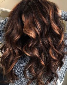 Fabulous dark to caramel hair color on long wavy hair