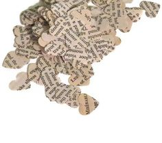 """Use heart-shaped paper punch to make confetti out of copies of the """"love"""" page in the dictionary.  Les Miserables Heart Confetti - Vintage Wedding Decorations - 200 Pieces on Etsy, $4.50 AUD"""