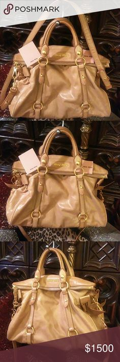 MIU MIU Butterscotch Leather Large Satchel Beautiful and unique MIU MIU large calfskin leather bag with detachable travel strap. Gorgeous and in great used Condition with minimal wear. Straps and handles in great condition. Interior in great condition. Golden hardware. Stunning and unique fold over convertible zipper closure. Comes with cards and original dust bag. Miu Miu Bags