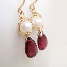 Use coupon code HOLIDAYS at checkout for 15% off your entire order! Sale runs now through Monday 11/28. These garnet and pearl earrings are made with faceted garnet gemstone briolettes in gorgeous, deep red shades topped with lustrous pearls wrapped with 14k gold filled wire. These earrings