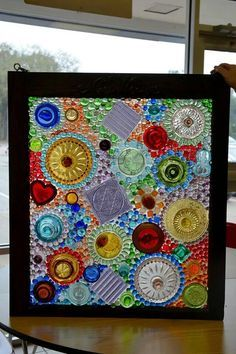 Old framed window using recycled glass pieces (including lids) to create a dimensional stain glass window . Using clear silicone adhesive . Mosaic Art, Mosaic Glass, Fused Glass, Mosaic Projects, Stained Glass Projects, Art Projects, Faux Stained Glass, Stained Glass Windows, Recycled Art