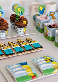 Nina's 1st birthday. Nina theme - all the things that have made up her first year. Love the Simpsons patty cake wraps with Nina's name on them!
