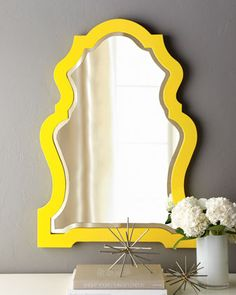 yellow framed mirror