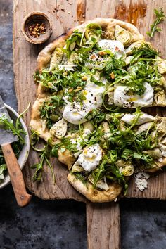Artichoke Pesto and Burrata Pizza with Lemony Arugula   halfbakedharvest.com #pizza #healthy #burrata #easyrecipes