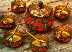 A set of wooden dishes with folk Khokhloma painting from Russia. #art #folk #painting #Russian