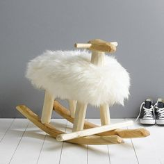 A handmade pinewood and sheepskin rocking sheep.This rocking sheep exudes wit and charm, and is the perfect addition to a child's room or living area. Versatile for kids and adults alike, it will look splendid in any interior and can also be used as a foot rest or a stool. A great unique gift for a friend or family member.Handmade from pinewood and upholstered with natural sheepskin.H55 x L82 x W49cm