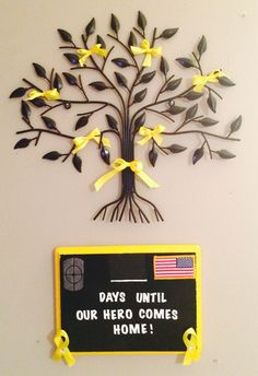 Yellow ribbon tree and chalkboard for countdown to return of soldier from deployment