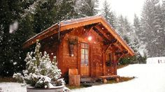 Chalet la Foret - Chamonix, Haute-Savoie, France. The Aiguille du Midi towers above an Alpine meadow bordered by larch trees, where you can relax and refresh under the stars in the hot tub, or fire up the wood-burning sauna for the perfect end to a day on the snow.