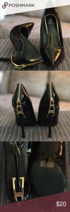 Black pumps with gold zipper detail... never worn Gorgeous black pumps from JustFab... never worn... they run snug... they are a size 9 but run small more for 8.5.  I hate to part with it, I just can't wear them JustFab Shoes Heels