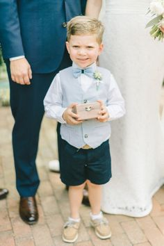 Ring bearer fashion, blue vest, blue bow-tie, navy blue shorts, Sperry shoes, follow this board for more adorable ring bearer style ideas // Elizabeth Fogarty