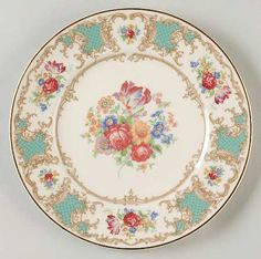 """""""Romance"""" china pattern with turquoise green rim, gold scroll flourishes, & red flowers from Syracuse."""