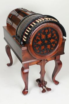the Wheelharp, a keyboard musical instrument that gives the player the ability to 'orchestrate' with a chromatic scale of sixty-one 61 actual bowed strings at one's own fingertips.    In other words – it's sort of a #steampunk version of an orchestral sound library.