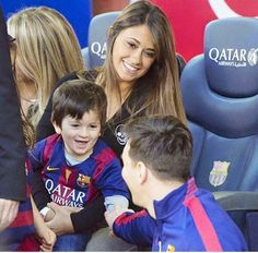 Messi's girlfriend and one of his sons Thiago