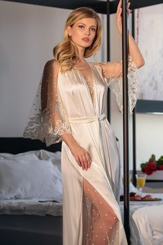 Discover a bridal lingerie set with a long silk robe made of weightless pure silk and sheer nightgown with embroidered dots on it. Robe's sleeves are hand-decorated with shiny sequins lace. You can complete it with a matching thongs. Lingerie Gown, Lingerie Outfits, Bridal Lingerie, Lingerie Set, Lingerie Photos, Pretty Lingerie, Beautiful Lingerie, Silk Robe Long, Wedding Night Lingerie